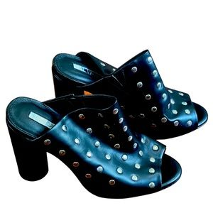 New Iliana black silver rivets heeled mules. 5 inch heels. Size 10. Have stretch